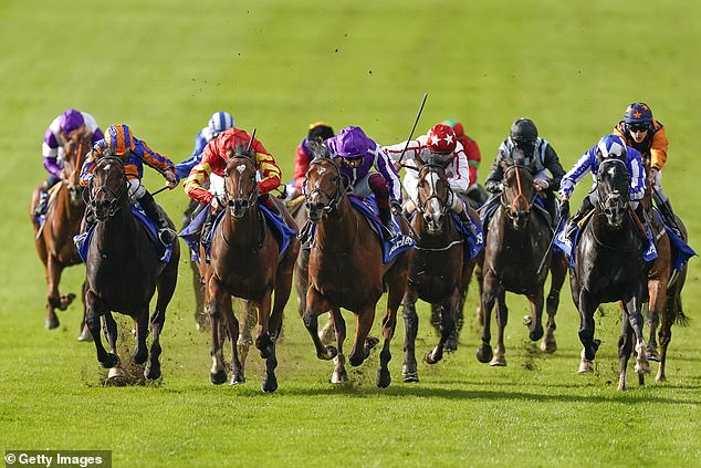 Frankie Dettori-ridden St Mark's Basilica holds off stablemate Wembley to win the Dewhurst Stakes